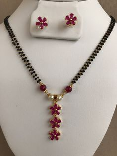Elegant double line black beads chain with ruby stones pendant and earrings set