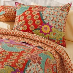 The homthreads Barizanz Quilt Set expertly combines unique patterns, flower designs and lively colors to create an eye-catching quilted blanket with boho chic flair. The beautiful red, orange, purple, yellow and blue hues of the quilted bedspread make it easy to incorporate into your bedroom's existing color palette, while matching pillow shams finish off the look. Each are reversible for two looks in one set. Quilt sets are available in queen and king sizes and include 2 pillow shams and...
