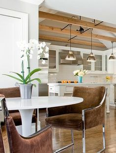 Love the upholstered chairs at the tulip table - Terrat Elms Interior Design