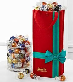 The Lindt Holiday Gift Bag is a festive holiday treat. The decorative, reusable felt bag comes with 100 smooth Lindor Truffles in an assortment of milk, dark, white, peanut butter and extra dark flavors Lindt Truffles, Lindt Lindor, Lindt Chocolate, Holiday Wishes, Holiday Treats, Holiday Gifts, Christmas Flowers, Christmas Fun, My Dessert