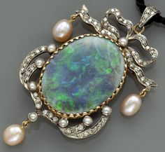 An opal, diamond and cultured pearl pendant.