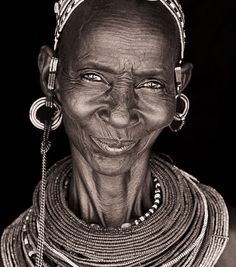 A kind and lovely face. The images capture their traditional dress.  Photographer John Kenny  Repinned from Alison Morgan