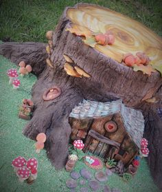 Fairy house and tree stump cake with toadstools and miniature furniture and acorns