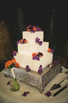 Wedding cake with orange and purple flowers.(Fall Wedding Cake)