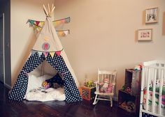 not for the teepee (although it's great) ~ I have a lil rocking chair just like that I could upcycle (for daughter) and I <3 the wooden crates. would be awesome for the boys room.
