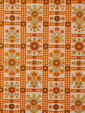 Very orange 70s wallpaper, as seen on frou-frou.dk