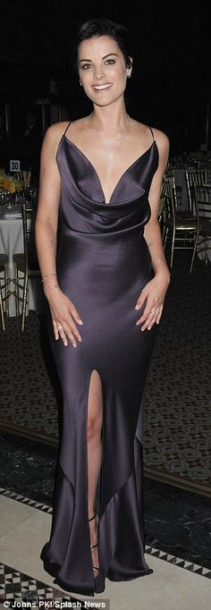Pretty in purple! Clad in a backless plum hued gown, the 31-year-old actress showed off he...