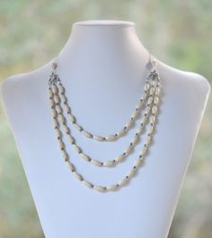Triple Strand Statement Necklace with Creamy River Stone Barell Beads and Pyrite in Silver. Unique Silver Strand Statement Necklace.