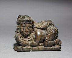 Фигурка прилегшей женщины. Найдена в Арслан-Таше, Сирия. IX-VIII вв. до н.э.