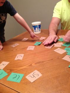 Contestants on brown paper and vowels on green. Word building. James learned how to read in a day.