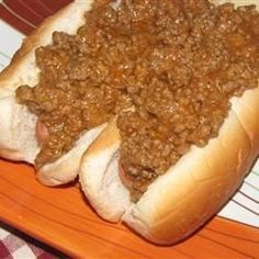 Ground beef is simmered in a tangy sauce with onion. My Grandfather owned a drive-in restaurant back in the This is his exact recipe for Coney Dogs from back in the day. I make this on special occasions and it is always hit with friends and family. Dog Recipes, Chili Recipes, Sauce Recipes, Cooking Recipes, 1950s Recipes, Muffin Recipes, Cooking Tips, Hot Dog Chili Sauce Recipe, Hot Dog Sauce