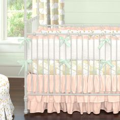 This @carouseldesigns soft pink crib bedding with hints of gold is so on trend. We love the ruffle crib skirt and sweet color scheme!