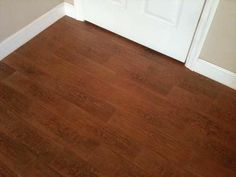 Ceramic tile that looks like wood floors. What a GREAT idea for bathrooms, laundry rooms and kitchens..