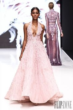 Pink color reads Spring, that's why designers love to use it to soften this harsh Winter season. Rose blush, Rosewood or pink bubble, it is simply sweet, romantic, and flirty. It gets even softer when combined with gold like Elie Saab, Ralph & Russo and Saiid Kobeisy's gowns. It reminds of a Winter garden at Zuhair Murad, with the Rosewood pink gown all embroidered in flowers. And when paired with black, it is elegantly well underlined and sophisticated like at Georges Chakra, Ralph &am...