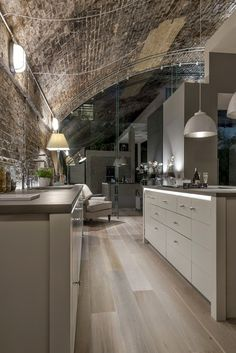 Like this kitchen due to exposed brickwork, great timber floors and lovely lighting.  Kitchen itself too contemporary.