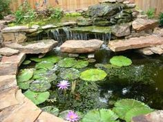 Hmmmm, another beautiful idea for our yard.  We already have a fish pond and we have discussed adding a layer to it for the waterfall effect!  I foresee my husband very busy.  Or I may have to figure out how to do some of these projects!