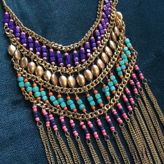 """Boho Tribal Beaded Layer Necklace from TV! Colorful beaded necklace from Disney Channel's hit TV show """"Jessie"""" that was worn on set! Gold metal and chain fringe. So boho chic! Free People Jewelry Necklaces"""