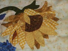 Sunflower block - Inspiration only. Nice mix of fabric, and a couple of petals look like Indian corn. (Don't I have some Indian Corn fabric?)