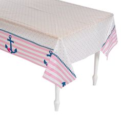 """Nautical Girl Tablecover - This adorable tablecloth is a perfect addition to your 1st birthday party supplies! Great for a sweet little sailor's big day, it's also an adorable way to keep your baby shower mess-and spill-free. Pretty pink stripes and an anchor make this plastic table cover a cute way to dress up your celebration table. Enjoy your buffet or dessert display even more knowing that cleanup will be quick and easy. Plastic. 54"""" x 108"""" © OTC $3.50"""