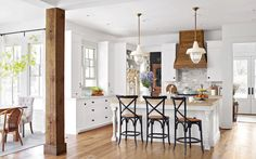 Farmhouse Kitchen - Wood Covered Hood