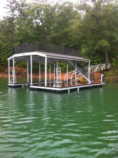 North Georgia Boat Lift & Marine Construction Company completed work on a brand new CAT 5 dock earlier this week. This dock, installed at Lake Fontana, features a standard single-slip combined with a wide-side to house the owner's boat. Ironwood decking was used in the construction of the main dock, the gangway also sporting it. Wahoo bumpers line the inside of the slip, protecting the boat from any damage. The upper level consists of a deck and roof. House Lift, Boat House, Lakefront Property, Boat Lift, Lake Cabins, Boat Dock, Lake Life, Rustic Design, Dock Ideas