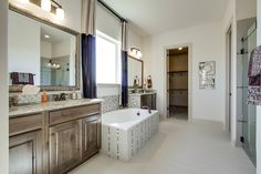 Gehan Homes Master Bathroom - Wood cabinet, granite countertops, tan baseboards. Dallas, Texas   Carnegie Ridge - Sycamore #Gehanhomes