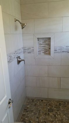 Custom shower with natural stone floor.