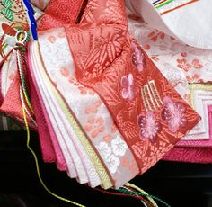 A close up of the layers of junihitoe worn by a hina (Girls Day holiday) doll.