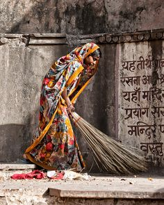 Temple Sweeper - I wish I could remember what those stick brooms were called....
