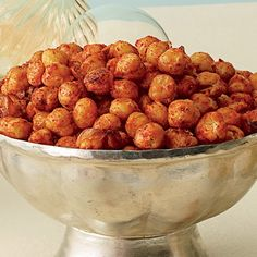 Mix two 15-ounce cans of rinsed and drained low-sodium chickpeas, 2 tablespoons olive oil, 1 1/2 tablespoons sugar, 1 teaspoon smoked paprika, 1/2 teaspoon salt, and 1/4 teaspoon each cayenne pepper and freshly ground black pepper. Bake in a single layer at 425°F for 22 to 24 minutes.