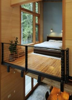 minimalist modern bedroom - like the earthy materials and the big window.