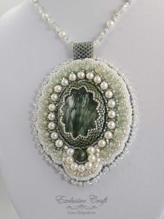 """Handcrafted green bead embroidered pendant """"Magic Dreams"""" with Seraphinite cabochons, natural shell pearl beads, Aventurine bead and Japanese seed beads. Handmade pendant is hanging from beaded cord a"""