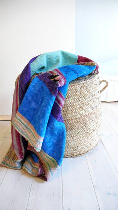 This vintage kantha blanket has been hand-picked in India for its rich colours, artisanal nature and beauty. Both sides are amazing! Made of layers of vintage saris, it has been lovingly hand stitched by artisans in India. Each one is unique and can never be reproduced. Each one is truly a piece of art. Due to its vintage nature and handmade construction, it may show slight imperfections,  markings or patches - this is considered a part of its charm and essence rather than a fau...