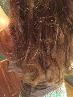 The consequences of trying to straighten curly hair when it's humid. All the frizz.