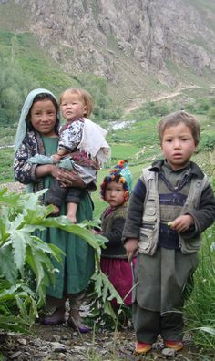 Hazara children . Afghanistan - eldest sibling caring for the younger ones
