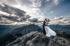 An adventurous hiking wedding, bride and groom hike up Ha Ling Peak, Canmore for the best mountain wedding photos! Photo by one-edition.ca.