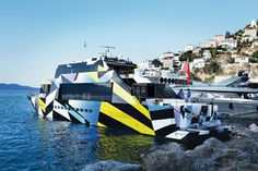 The yacht of billionaire art collector Dakis Joannou, for which he commissioned the artist Jeff Koons to paint the exterior, docked at Hydra's port.