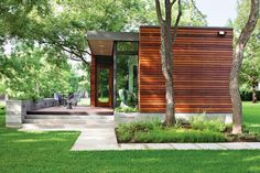 Add a single pitch, sloped roof and some charred cedar siding and you've got my dream house...  wood clad exterior in Austin