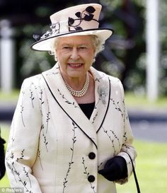 WoW! This is my most favourite outfit that I have ever seen the Queen wear.  What a lovely neckline. Not at all matronly!  Whoever designed this outfit, understands the Queens shape and knows how she can best show off her figure. Well done!!