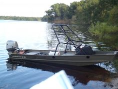 Sick jon boat 14' jon boat converted into a wake board boat! With a 30 hp outboard motor...