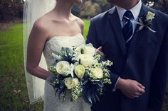 WildFlowers - Charleston, SC, United States. Bride's bouquet: ivory roses, blue privet berries, grey dusty miller, etc. - Photo Credit: http://leahandmark.com/