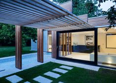 Richmond Park gatehouse with a contemporary timber and concrete extension connected by a glass-lined corridor
