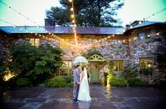 Rainy wedding umbrella photoshoot under bistro lights in beautiful courtyard north of Boston willowdaleestate.com
