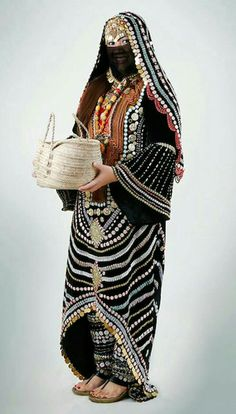 Yamen the old kingdom of sabaa .traditional clothes of women  from hadramawt