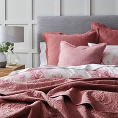 Introduce coastal charm to your bedroom with the Coral Bay quilt cover. Crafted from 250 thread count cotton, a painterly design of coral in soft blue hues is finished with a filled piping trim and stylish printed reverse. Calming and contemporary, complete the look with European pillowcases. #quiltcover #doonacover #duvetcover #coastalstyle #coastaldecor
