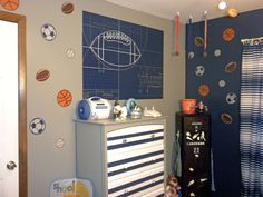 painted football mural and sports ball stickers / painted dresser and locker / boys sports room