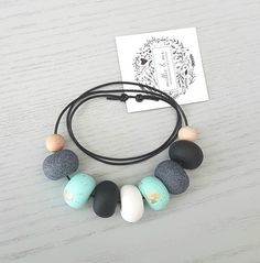 Beautiful fresh colours make a stunning and perfect piece. A beautiful piece to add that special touch to your Summer wardrobe. Each clay bead is rolled and formed by hand. The clay and two natural wooden beads are strung together on a genuine black leather cord. This necklace is