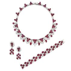 Impressive ruby and diamond parure, Bulgari, circa 1945 Comprising: a necklace of fringe design, set with circular-cut and oval rubies, highlighted with circular-cut and baguette diamonds, length approximately 405mm; a bracelet, length approximately 173mm; and a pair of pendent earrings, post and hinged back fittings; unsigned, each with French assay marks, bracelet with partial French maker's mark, fitted case.