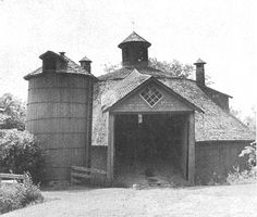 Note the ventilating 'chimneys and cupola of this same great rounded barn. And the clever use of a square window over the ramp entrance.