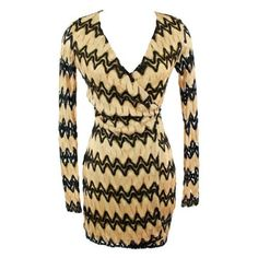 Belle Wrap Dress - One of the best silhouettes ever made this wrap dress should be a staple in every woman's closet. Fashionable, comfortable, and one of the trendiest items of the season the black and gold zigzag knit wrap dress is something that every woman should have. Ask yourself who wouldn't want to be spotted in this amazing dress?! Stacking large bangles over the long sleeves of the dress, and adding just the right necklace you will feel your confidence growing. Paired with black…